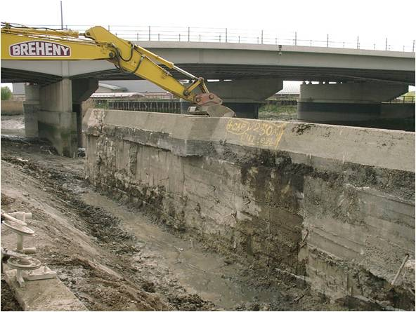 Vertical river wall removed to create natural sloping bank