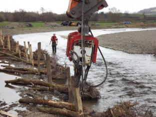 Driving stakes with vibro piling hammer