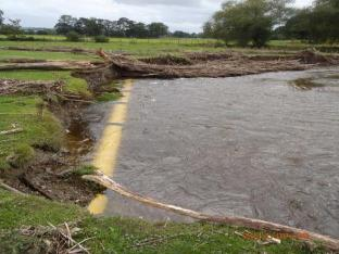 River Rhiw high pressure gas main exposed by erosion
