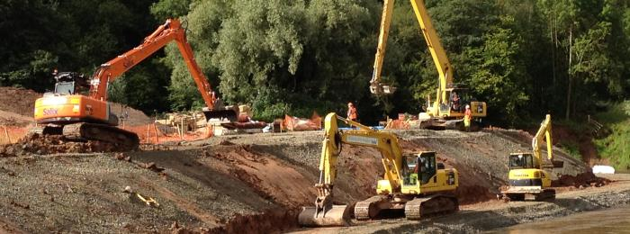 River Teme 4 machines placing fill