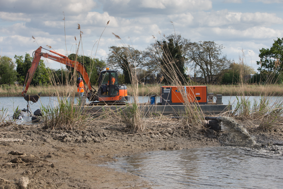 Pontoon/long reach excavator and silt pump