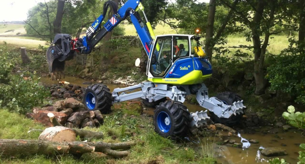 Spider Machine, Menzi Muck, places large woody debris in the river bed