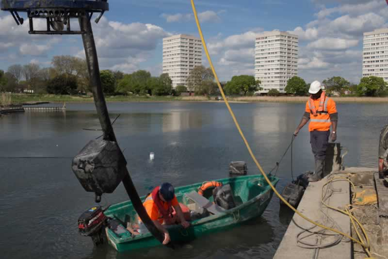 Desilting with the Woodberry skyline