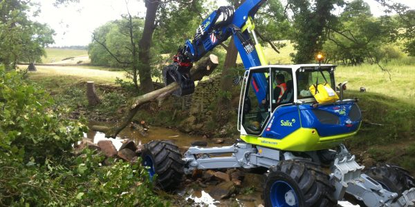 Spider Menzi Muck Excavator moving large woody debris below Swinsty Reservoir