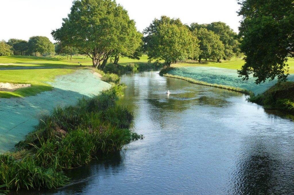 Planted Coir Rolls and hydroseeding preventing erosion on the river bank