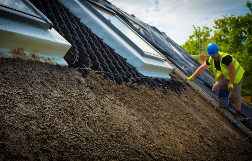 Layer of soil over geotextile cells