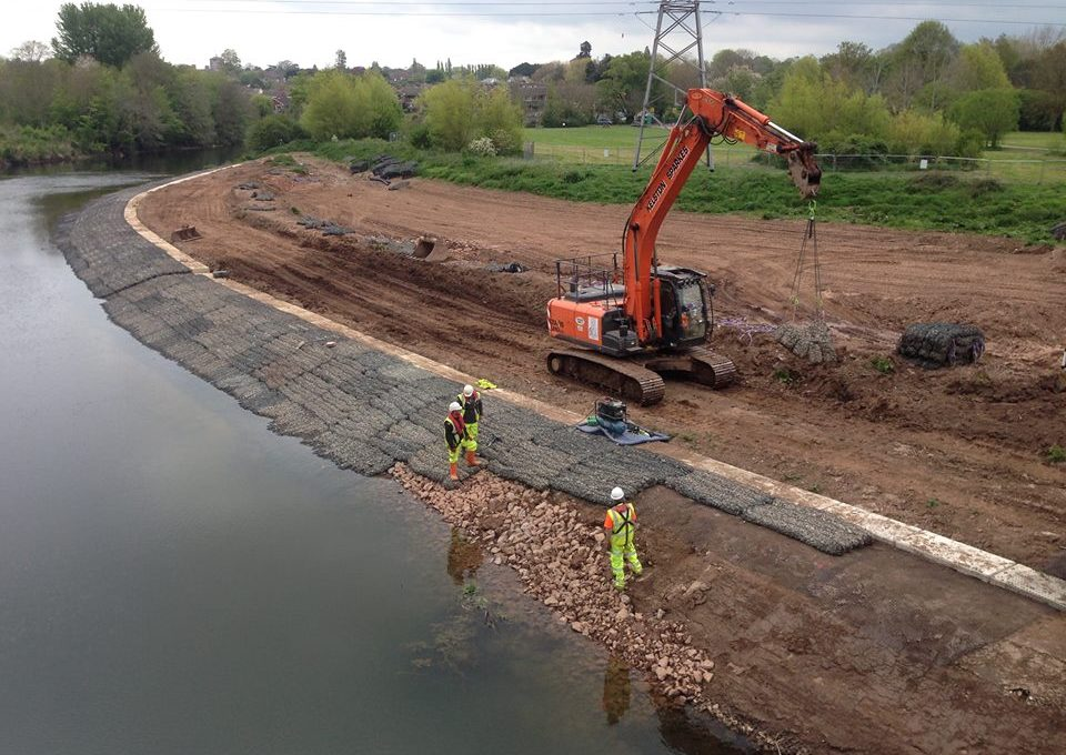 Rock Mattresses being placed on the river bank