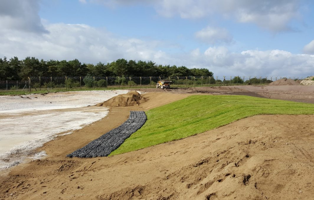 Shear Stress Turf Spillway Protection with Rock Roll Mattress Toe Protection