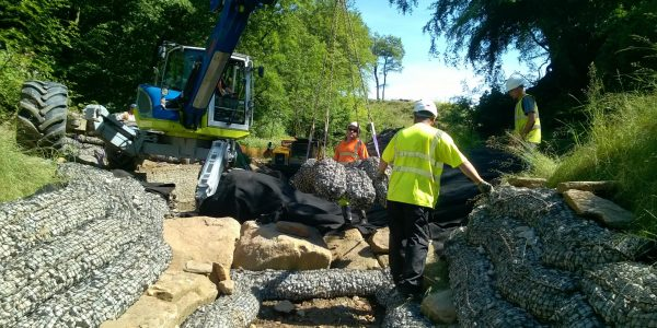 Jack Keys laying Rock Mattresses in river bed for erosion control